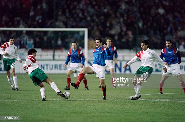 French soccer player Eric Cantona fights for the ball during a qualification match for the world cup 1994 between France and Bulgaria on November 17...
