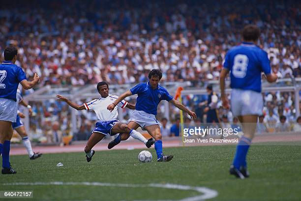 French soccer player Jean Tigana slides into Italian player Franco Baresi during the 1986 World Cup match at Olimpico Stadium France defeated Italy...
