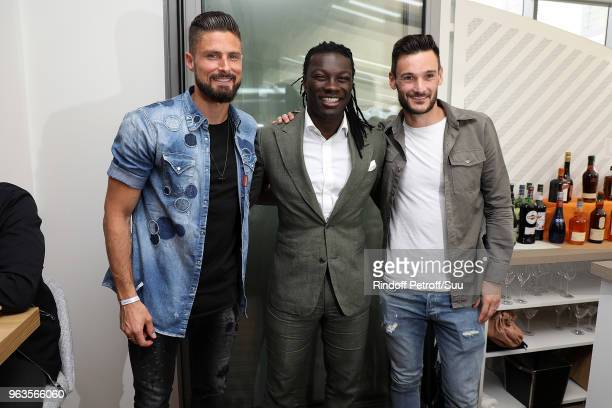 French soccer player Olivier Giroud Bafe Gomis and Hugo Lloris attends the 2018 French Open Day Three at Roland Garros on May 29 2018 in Paris France