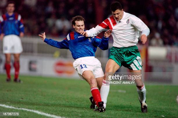 French soccer player Vincent Guerin fights for the ball with his bulgarian counterpart Liouboslav Penev during a qualification match for the world...
