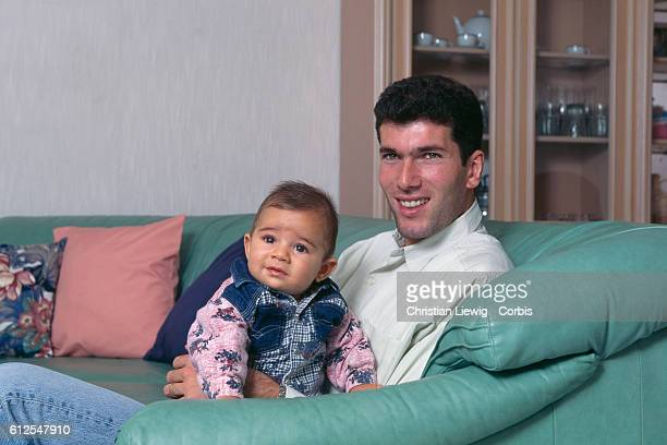 French soccer player Zinedine Zidane at home with his son Enzo