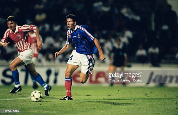 French soccer player Zinedine Zidane during his first cap match with the French national football team on 17 August 1994 coming on as substitute in...