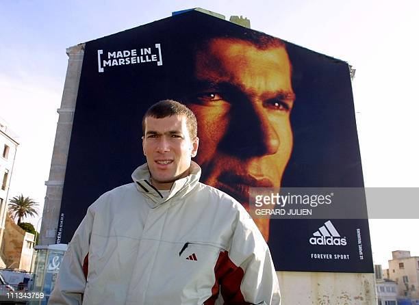 French soccer player Zinedine Zidane poses 29 January 2001 in front of a mural bearing his image on a building in his home city of Marseille AFP...