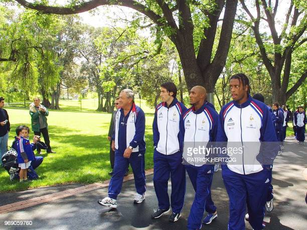 French soccer players Philippe Christanval Nicolas Anelka and Robert Pires walk in a garden of Melbourne 11 November 2001 few hours before the...