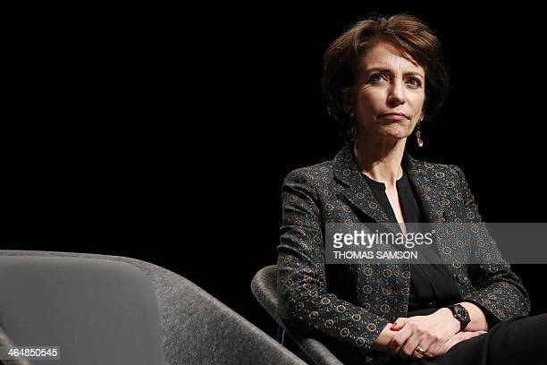 French Social Affairs and Health Minister Marisol Touraine listens to the French Prime Minister as he gives a speech focused on the fight against...