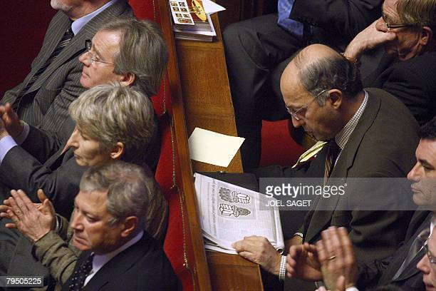French socialist deputy Laurent Fabius reads a newspaper on February 04 2008 at the Versailles castle near Paris where senators and members of...
