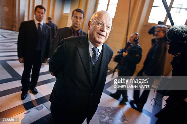 French socialist Michel Charasse a friend of French prefect Claude Erignac walks in a corridor of the Paris courthouse 12 November 2007 at the first...