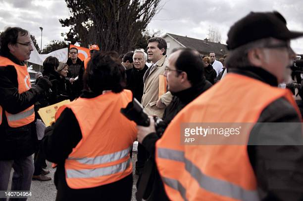 French Socialist MP and President of the SaoneetLoire departement Arnaud Montebourg flanked by Bourgogne region President Francois Patriat listens to...