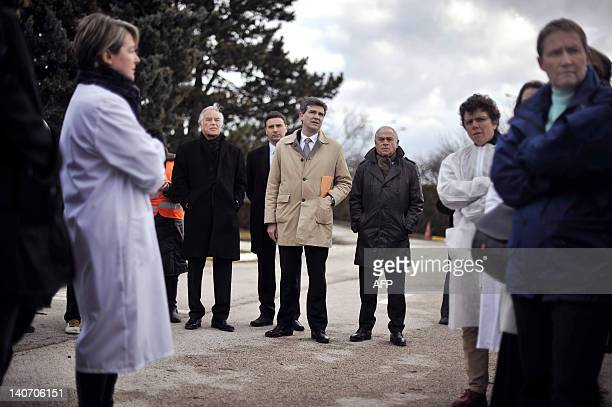 French Socialist MP and President of the SaoneetLoire departement Arnaud Montebourg flanked by Bourgogne region President Francois Patriat speaks to...