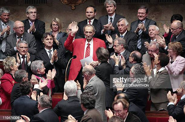 French socialist MP Patrick Roy is applauded by his colleagues on March 15 2011 at the national assembly in Paris prior to take part in the session...
