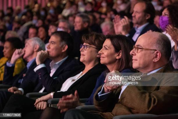 French Socialist Party candidate for the April 2022 presidential election Anne Hidalgo sits by former Interior minister Bernard Cazeneuve , Lille's...