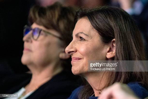 French Socialist Party candidate for the April 2022 presidential election Anne Hidalgo sits by Lille's mayor Martine Aubry during her formal...