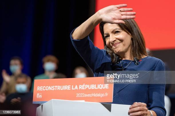 French Socialist Party candidate for the April 2022 presidential election Anne Hidalgo salutes the audience at the end of her speech during her...