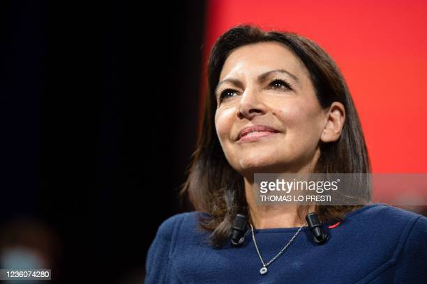 French Socialist Party candidate for the April 2022 presidential election Anne Hidalgo smiles at the end of her speech during her formal inauguration...
