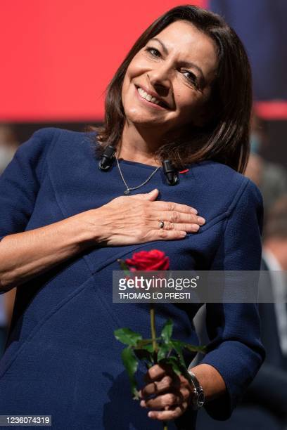 French Socialist Party candidate for the April 2022 presidential election Anne Hidalgo holds her party's emblem, a rose, at the end of her speech...