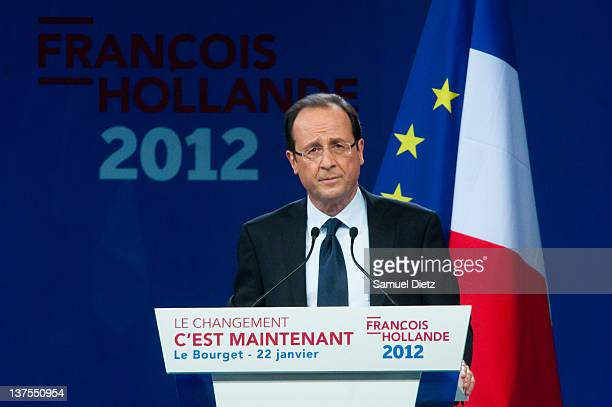 French Socialist Party candidate for the upcoming Presidential Election Francois Hollande addresses the audience during a campaign meeting at Le...