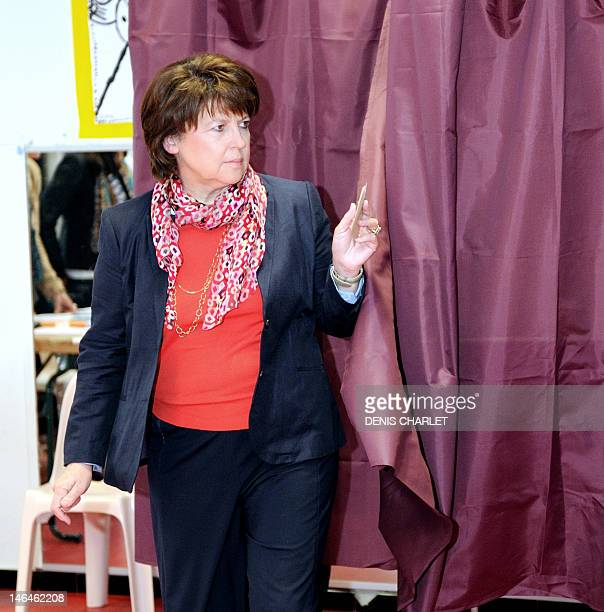 French Socialist Party First Secretary Martine Aubry leaves the polling booth prior to cast her ballot during the second round of the French...