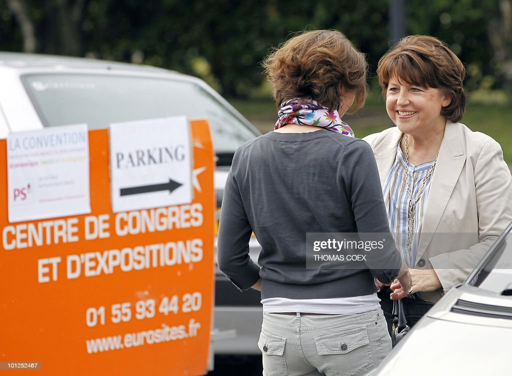 French Socialist party leader Martine Aubry (R) talks with her advisor as she arrives at the French Socialist Party national convention dedicated to a 'new model of development', on May 29, 2010 in La plaine Saint Denis, outside Paris. Aubry said today that 'real work begins' for the 2012 presidential election.