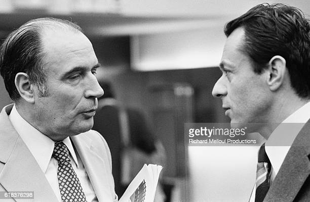 French Socialist Party leaders Francois Mitterrand and Michel Rocard converse in Paris