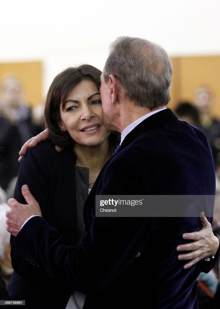 French socialist party (PS) Mayor of Paris Bertrand Delanoe kisses Paris PS mayoral candidate Anne Hidalgo during a campaign meeting on February 11, 2014 in Paris, France. Anne Hidalgo is currently campaigning to become Mayor of Paris in the run up to the Mayoral elections in March 2014.