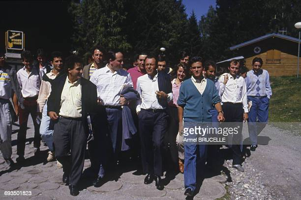 French Socialist Party politician Michel Rocard surrounded by young supporters of his politics at Les Arcs Var France 5th September 1986 Foreground...