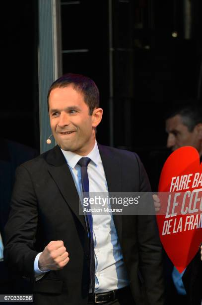 French Socialist Party Presidential candidate Benoit Hamon salutes the crowd as he arrives for a political meeting Place de la Republique on April 19...