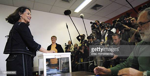 French Socialist Party presidential candidate Segolene Royal casts her ballot at a polling station 06 May 2007 in Melle central France for the second...