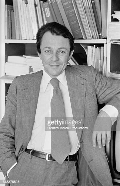French socialist politician Michel Rocard leans on a bookshelf