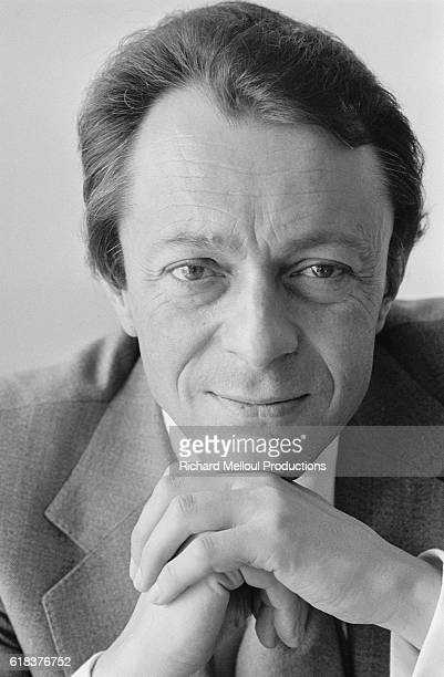 French socialist politician Michel Rocard poses with his hands folded
