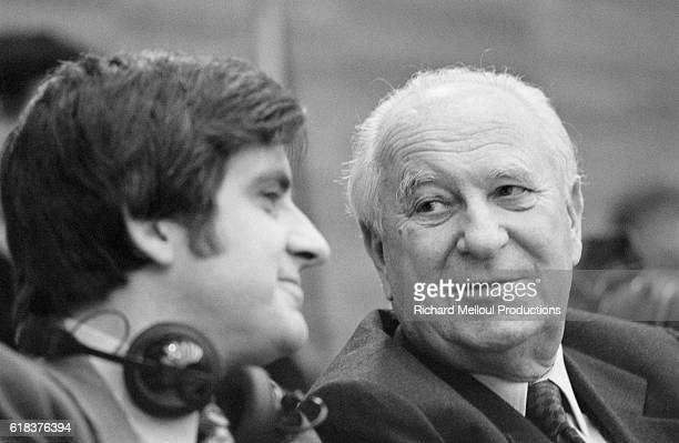French Socialist politicians JeanPierre Chevenement and Gaston Deferre converse during a summit of southern European Socialists