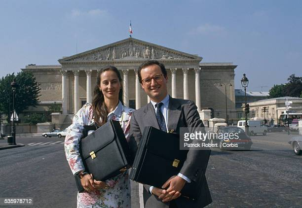 French socialist politicians Segolene Royal and husband Francois Hollande stand outside the National Assembly in Paris