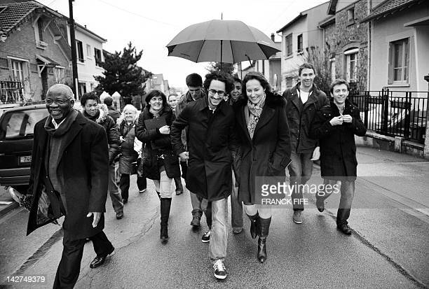 French Socialist President of the PoitouCharentes region Segolene Royal and her eldest son Thomas Hollande go door to door in Bagneux outside Paris...