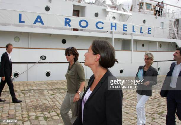 French socialist president of the PoitouCharentes region Segolene Royal walks near a boat followed by her press officer Agnes Longueville and her...
