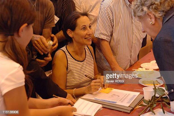 French socialist presidential candidate Segolene Royal at the fete de la rose in Lorgues France on May 28 2006 Signing books