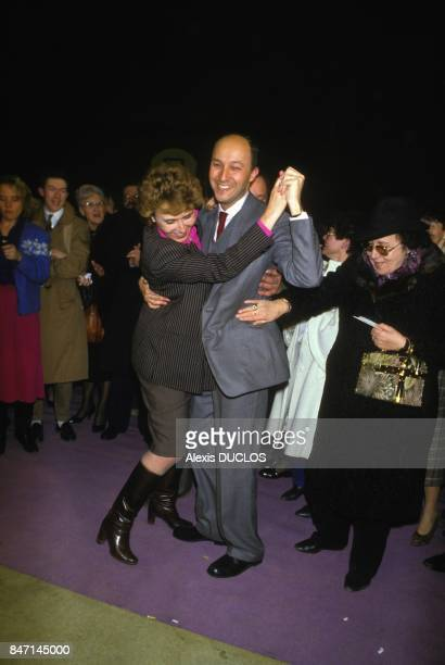 French Socialists Edith Cresson and Laurent Fabius dancing during campaign for general election on February 24 1986 in Vienne France