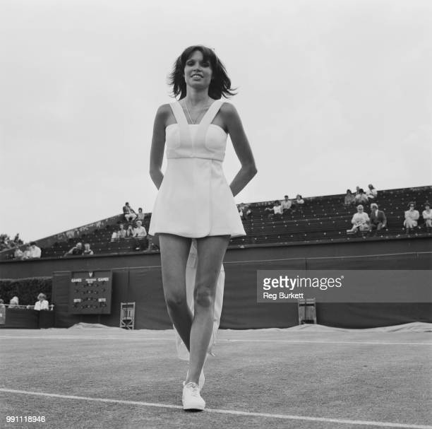 French socialite Dominique Grazia, wife of tennis player Ilie Nastase, modelling tennis outfit at Queen's Club, London, UK, 24th June 1973.