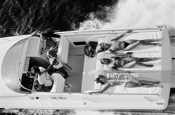 French socialite Jacqueline Veyssière queen of the nights of SaintTropez with friends aboard a 'Cigarette' a boat manufactured by Leader Racing...