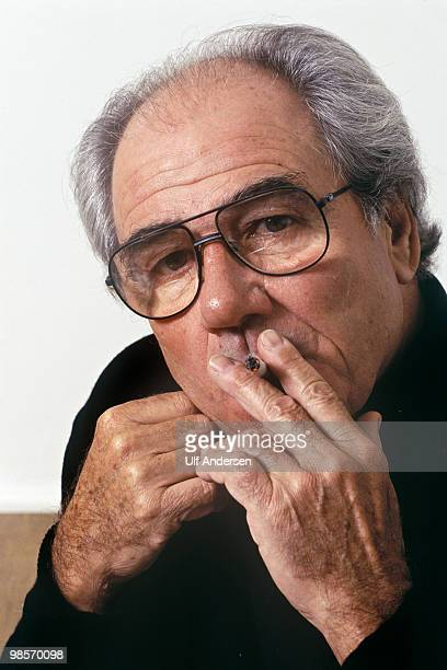 French sociologist, philosopher and cultural theorist Jean Baudrillard poses at home on November 15,1985 in Paris,France.