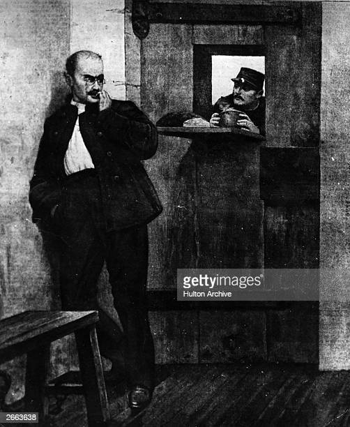 French soldier Alfred Dreyfus in prison on Devil's Island Dreyfus was wrongly accused of treason and acquitted in 1906 Original Publication People...