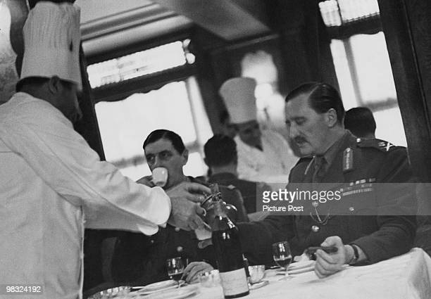 French soldier and politician General Charles de Gaulle takes lunch with British General Edward Spears 1940 Original Publication Picture Post 375...