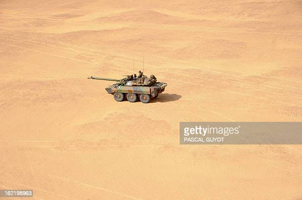 A French soldier drives an armoured vehicle on February 17 2013 in the desert near Bourem northern Mali A Frenchled military intervention launched on...