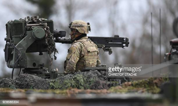 French soldier follows an artillery shooting session during the 'Dynamic Front 18' exercise in Grafenwoehr, near Eschenbach, southern Germany, on...
