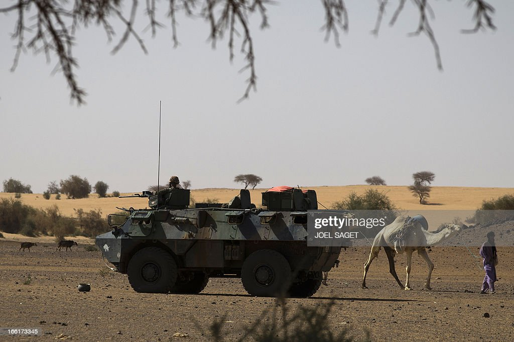 A French soldier from the 126 RI (Regiment Infantery) is on guard on a armoured vehicle during the Operation Gustav, a hunt for Islamist fighters in a valley in northern Mali and one of France's largest military operations during its three-month intervention in its former colony, on April 9, 2013, 105 km North of Gao. Operation Gustav comes with France preparing to withdraw three-quarters of the 4,000 troops it deployed in January to block a feared advance on the Malian capital Bamako by Al Qaeda-linked insurgents.