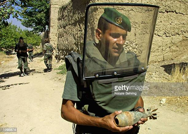 French soldier from the 2nd Engineer Regiment of the French Foreign Legion carries an explosive device out of the village of Dasawe Aole north of...