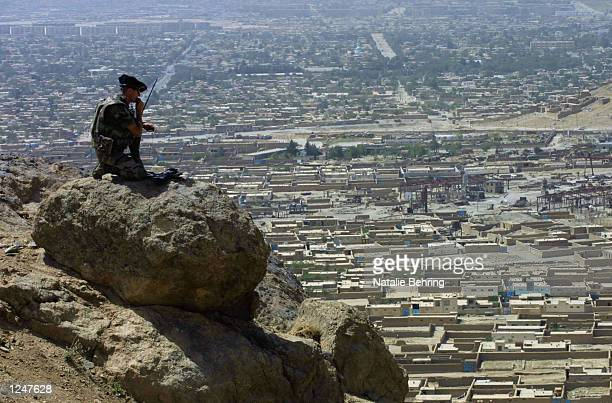 French soldier from the 7th Mountain Regiment part of the International Security and Assistance Force stands on a boulder overlooking Kabul during a...