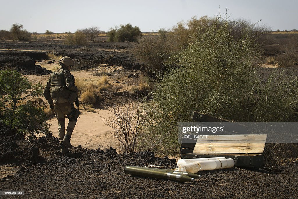 A French soldier from the 92nd Infantery Regiment stands on April 7, 2013 near boxes containing 340 Chinese rockets allegedly belonging to Mujao forces, found some 105 kilometers North of Gao. A French force of 1,000 soldiers has begun a sweep of a river valley thought to be a logistics base for armed Islamists near the Malian city of Gao, an AFP journalist accompanying the mission said. Operation Gustav, one of France's largest actions since its intervention against insurgents in January, will involve dozens of tanks, helicopters, drones and airplanes, said General Bernard Barrera, commander of the French land forces in Mali.