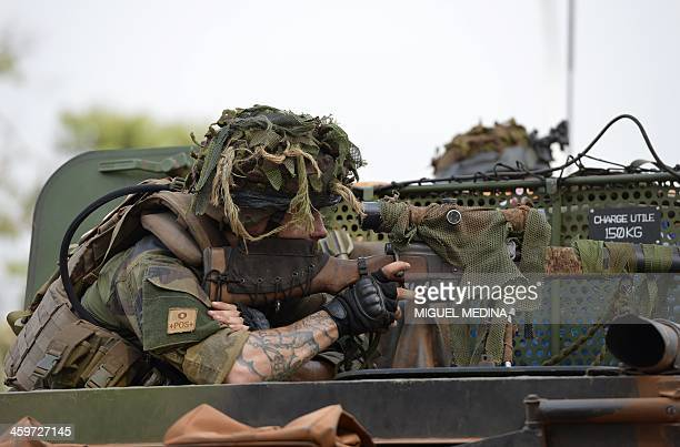 A French soldier from the Sangaris operation looks through the scope of his rifle on an armored vehicle in Bangui on December 28 2013 The United...