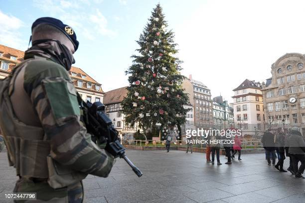 A French soldier from the Sentinelle security operation stands guard next to the Christmas tree on Place Kleber in central Strasbourg on December 13...