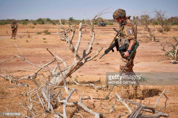 French soldier holds a detector while searching for the presence of IED during the Burkhane Operation in northern Burkina Faso on November 12, 2019....