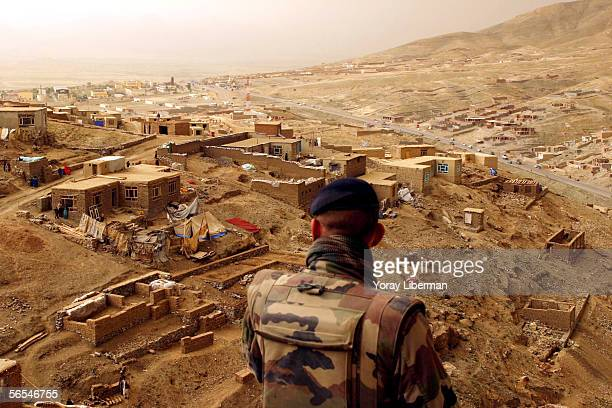 French soldier look down at an afghan village on April 29 2004 in Kabul Afghanistan The French soldiers are part of the ISAF a NATO force providing...